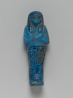 <em>Shabty of the Princess Nesi-Khonsu</em>, ca. 1075-945 B.C.E. Faience, 6 1/2 x 2 3/8 x 1 1/2 in. (16.5 x 6 x 3.8 cm). Brooklyn Museum, Gift of Evangeline Wilbour Blashfield, Theodora Wilbour, and Victor Wilbour honoring the wishes of their mother, Charlotte Beebe Wilbour, as a memorial to their father, Charles Edwin Wilbour, 16.185. Creative Commons-BY (Photo: Brooklyn Museum, 16.185_front_PS2.jpg)