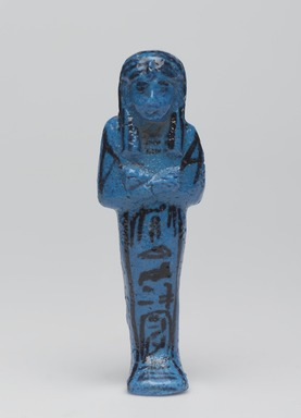 <em>Funerary Figurine of King Pinudjem I</em>, ca. 1025-1007 B.C.E. Faience, 4 5/16 × 1 3/8 × 1 in. (10.9 × 3.5 × 2.5 cm). Brooklyn Museum, Gift of Evangeline Wilbour Blashfield, Theodora Wilbour, and Victor Wilbour honoring the wishes of their mother, Charlotte Beebe Wilbour, as a memorial to their father, Charles Edwin Wilbour, 16.189. Creative Commons-BY (Photo: , 16.189_front_PS9.jpg)