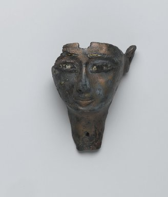 <em>Face from a Composite Statue</em>, 1075-656 B.C.E. Bronze, stone?, gold, 1 5/8 x 2 1/16 x 2 13/16 in. (4.1 x 5.3 x 7.2 cm). Brooklyn Museum, Gift of Evangeline Wilbour Blashfield, Theodora Wilbour, and Victor Wilbour honoring the wishes of their mother, Charlotte Beebe Wilbour, as a memorial to their father, Charles Edwin Wilbour, 16.198. Creative Commons-BY (Photo: Brooklyn Museum, 16.198_front_PS2.jpg)