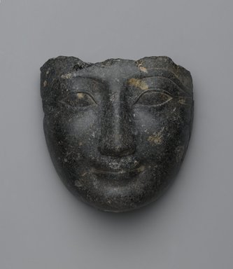 <em>Face from a Sarcophagus Cover</em>, ca. 1539-1400 B.C.E. Granite, 6 5/8 × 6 1/2 × 3 3/8 in. (16.8 × 16.5 × 8.6 cm). Brooklyn Museum, Gift of Evangeline Wilbour Blashfield, Theodora Wilbour, and Victor Wilbour honoring the wishes of their mother, Charlotte Beebe Wilbour, as a memorial to their father, Charles Edwin Wilbour, 16.207. Creative Commons-BY (Photo: Brooklyn Museum, 16.207_PS2.jpg)