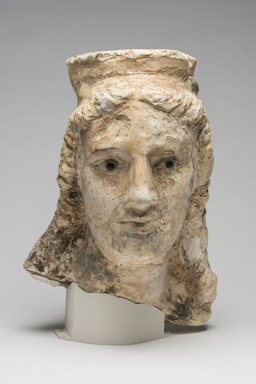 Graeco-Egyptian. <em>Female Head</em>, 1st century B.C.E.-1st century C.E. Limestone, stone, pigment, 14 x 10 1/4 in. (35.5 x 26 cm). Brooklyn Museum, Gift of Evangeline Wilbour Blashfield, Theodora Wilbour, and Victor Wilbour honoring the wishes of their mother, Charlotte Beebe Wilbour, as a memorial to their father, Charles Edwin Wilbour, 16.236. Creative Commons-BY (Photo: Brooklyn Museum, 16.236_overall_at_PS11.jpg)