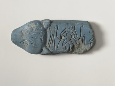 "<em>Fragment of ""Magic Knife,""</em> ca. 1759-after 1630 B.C.E. Frit, 1 3/8 x 3 9/16 in. (3.5 x 9 cm). Brooklyn Museum, Gift of Evangeline Wilbour Blashfield, Theodora Wilbour, and Victor Wilbour honoring the wishes of their mother, Charlotte Beebe Wilbour, as a memorial to their father, Charles Edwin Wilbour