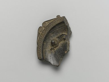 Graeco-Egyptian. <em>Fragment of Circular Dish</em>, middle 4th century C.E. Steatite, 3/4 x 1 1/2 x 2 1/2 in. (1.9 x 3.8 x 6.4 cm). Brooklyn Museum, Gift of Evangeline Wilbour Blashfield, Theodora Wilbour, and Victor Wilbour honoring the wishes of their mother, Charlotte Beebe Wilbour, as a memorial to their father, Charles Edwin Wilbour, 16.580.164. Creative Commons-BY (Photo: Brooklyn Museum, 16.580.164_front_PS1.jpg)