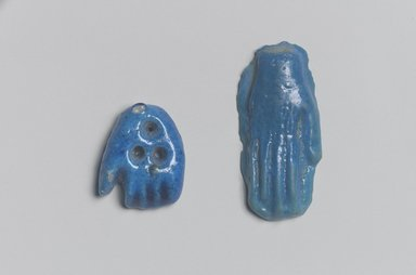 <em>Open Left Hand as Amulet</em>. Faience, 11/16 x 7/8 in. (1.8 x 2.3 cm). Brooklyn Museum, Gift of Evangeline Wilbour Blashfield, Theodora Wilbour, and Victor Wilbour honoring the wishes of their mother, Charlotte Beebe Wilbour, as a memorial to their father Charles Edwin Wilbour, 16.580.34. Creative Commons-BY (Photo: , 16.580.34_16.580.35.jpg)