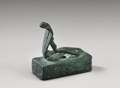 <em>Snake Coffin (Atum)</em>, 664–343 B.C.E. Bronze, lead, 2 15/16 x 1 7/16 x 3 1/8 in. (7.5 x 3.6 x 7.9 cm). Brooklyn Museum, Gift of Evangeline Wilbour Blashfield, Theodora Wilbour, and Victor Wilbour honoring the wishes of their mother, Charlotte Beebe Wilbour, as a memorial to their father, Charles Edwin Wilbour, 16.600. Creative Commons-BY (Photo: Brooklyn Museum (Gavin Ashworth,er), 16.600_Gavin_Ashworth_photograph.jpg)