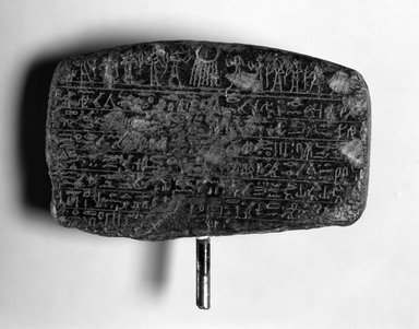 <em>Upper Part of Cippus of Horus</em>, 332-30 B.C.E. Steatite, 4 x 1 1/4 x 2 5/8 in. (10.1 x 3.2 x 6.6 cm). Brooklyn Museum, Gift of Evangeline Wilbour Blashfield, Theodora Wilbour, and Victor Wilbour honoring the wishes of their mother, Charlotte Beebe Wilbour, as a memorial to their father, Charles Edwin Wilbour, 16.652. Creative Commons-BY (Photo: Brooklyn Museum, 16.652_back_bw_IMLS.jpg)