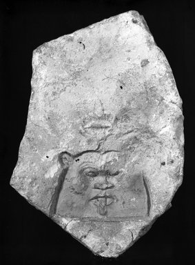 <em>Sculptor's Trial Relief of Bes</em>, ca. 1352-1336 B.C.E. Limestone, 8 × 5 9/16 × 1 5/16 in. (20.3 × 14.2 × 3.4 cm). Brooklyn Museum, Gift of Evangeline Wilbour Blashfield, Theodora Wilbour, and Victor Wilbour honoring the wishes of their mother, Charlotte Beebe Wilbour, as a memorial to their father, Charles Edwin Wilbour, 16.67. Creative Commons-BY (Photo: Brooklyn Museum, 16.67_bw_IMLS.jpg)
