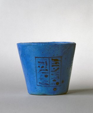 <em>Cup</em>, ca. 985-974 B.C.E. Faience, 2 5/16 x Diam. 2 11/16 in. (5.9 x 6.9 cm). Brooklyn Museum, Gift of Evangeline Wilbour Blashfield, Theodora Wilbour, and Victor Wilbour honoring the wishes of their mother, Charlotte Beebe Wilbour, as a memorial to their father, Charles Edwin Wilbour, 16.73. Creative Commons-BY (Photo: Brooklyn Museum, 16.73_SL1.jpg)