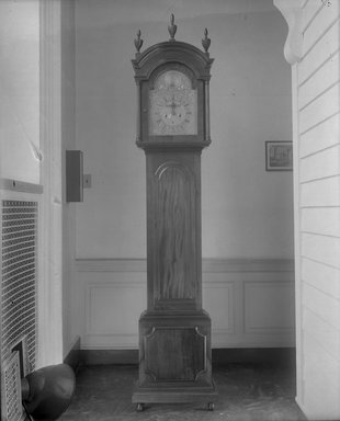 William Claggett (American, 1696-1749). <em>Tall Clock</em>, 1720-1725. Mahogany (tulip poplar, chestnut, pine secondary woods), glass, brass, 98 1/4 x 21 1/4 x 10 1/2 in. (249.6 x 54 x 26.7 cm). Brooklyn Museum, Robert B. Woodward Memorial Fund, 18.156. Creative Commons-BY (Photo: Brooklyn Museum, 18.156_installation_glass_bw.jpg)