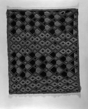 Kuba (Shoowa subgroup). <em>Raffia Cloth Panel Marked K307</em>, 20th century. Raffia, 22 7/8 x 19 5/16 in. (58.0 x 49.0 cm). Brooklyn Museum, Gift of The Roebling Society, 1989.11.7. Creative Commons-BY (Photo: Brooklyn Museum, 1989.11.7_bw.jpg)