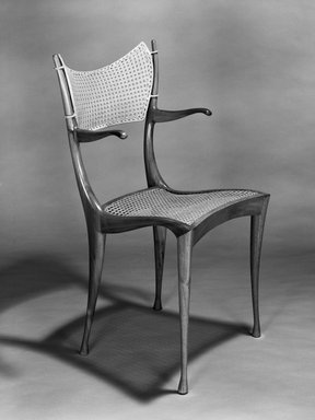 "Dan Johnson Studio, a Division of Arch Industries. <em>""Gazelle"" Armchair</em>, designed 1956. Walnut, cane, brass, 37 11/16 x 21 x 23in. (95.7 x 53.3 x 58.4cm). Brooklyn Museum, H. Randolph Lever Fund, 1989.113. Creative Commons-BY (Photo: Brooklyn Museum, 1989.113_bw.jpg)"