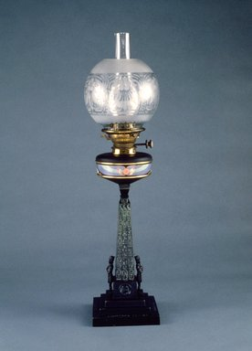 "J. Holgate & Company. <em>""Cleopatra's Needle"" Table Lamp</em>, ca. 1877. Black patinated bronze, porcelain, brass, glass, 29 1/2 x 6 3/4 x 6 3/4 in. Brooklyn Museum, Gift of Isabel Shults, by exchange, 1989.114a-d. Creative Commons-BY (Photo: Brooklyn Museum, 1989.114a-d_reference_SL3.jpg)"