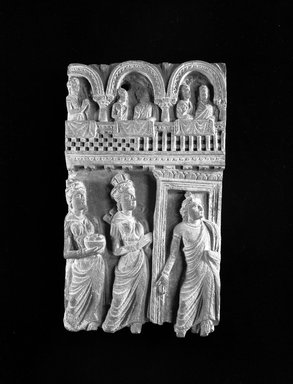 <em>Buddhist Narrative Relief</em>, 2nd-4th century C.E. Grey micaceous schist, 13 1/4 x 7 15/16 x 2 1/2 in. Brooklyn Museum, Gift of Dr. Samuel Eilenberg, 1989.146.2. Creative Commons-BY (Photo: Brooklyn Museum, 1989.146.2_view2_bw.jpg)