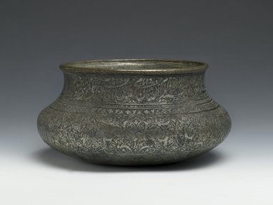 <em>Wine Bowl Inscribed with the Names of the Twelve Shi`a Imams</em>, late 16th-early 17th century. Copper; cast, raised, and turned, then tinned; engraved and inlaid, H: 3 1/2 in. (8.9 cm). Brooklyn Museum, Gift of Mrs. Charles K. Wilkinson in memory of her husband, 1989.149.4. Creative Commons-BY (Photo: Brooklyn Museum, 1989.149.4_PS2.jpg)