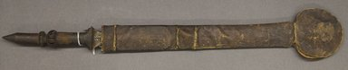 Yaka. <em>Sword in Scabbard</em>, 19th or 20th century. Iron, wood, hide, 25 x 2 x 1 3/8in. (63.5 x 5.1 x 3.5cm) (sword). Brooklyn Museum, Gift of Frederick and Claire Mebel, 1989.172a-b. Creative Commons-BY (Photo: Brooklyn Museum, 1989.172a-b_PS10.jpg)