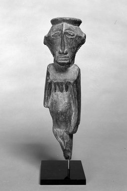"Buyu. <em>Standing Figure</em>, 19th or 20th century. Wood, pigment ""accretion"", 16 1/2 x 4 3/4 x 5 in. (41.9 x 12.1 x 12.8 cm). Brooklyn Museum, Gift of Drs. John I. and Nicole Dintenfass, 1989.173.1. Creative Commons-BY (Photo: Brooklyn Museum, 1989.173.1_bw.jpg)"