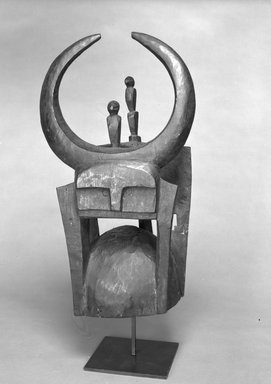 Tusian. <em>Head Crest Surmounted by Stylized Buffalo Figure (Kable).</em>, 20th century. Wood, ferrous nails, pigment, applied/accumulated materials, 23 x 13 1/2 x 9 in. (58.4 x 34.3 x 22.9 cm). Brooklyn Museum, Gift of Drs. John I. and Nicole Dintenfass, 1989.173.2. Creative Commons-BY (Photo: Brooklyn Museum, 1989.173.2_bw.jpg)