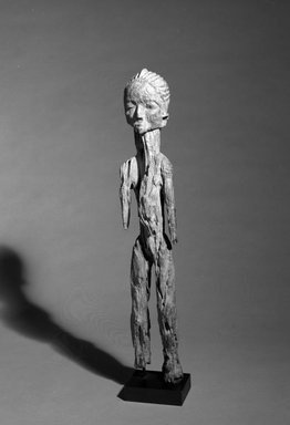 Lobi. <em>Male figure (Bateba)</em>, 19th century. Wood, 24 x 4 1/4 x 3 1/2 in. (61.0 x 10.8 x 8.9 cm). Brooklyn Museum, Gift of Ruth Lippman in memory of Abbott A. Lippman, 1989.174.1. Creative Commons-BY (Photo: Brooklyn Museum, 1989.174.1_bw.jpg)