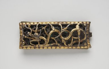 <em>Iron Fitting with Dragon Decoration</em>, ca. 15th century. Iron, gilt, leather, 3 1/2 x 1 3/8in. (8.9 x 3.5cm). Brooklyn Museum, Gift of Georgia and Michael de Havenon, 1989.176.3. Creative Commons-BY (Photo: Brooklyn Museum, 1989.176.3_PS11.jpg)