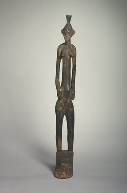 Senufo. <em>Rhythm Pounder (Deble) with Female Figure</em>, 20th century. Wood, 42 x 4 3/4 x 4 in. (106.7 x 12.1 x 10.2 cm). Brooklyn Museum, The Adolph and Esther D. Gottlieb Collection, 1989.51.12. Creative Commons-BY (Photo: Brooklyn Museum, 1989.51.12.jpg)