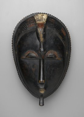 Baule. <em>Mblo Portrait Mask</em>, late 19th-early 20th century. Wood, pigment, 13 3/8 x 8 7/16 x 6 1/8 in. (34 x 21.5 x 15.5 cm). Brooklyn Museum, The Adolph and Esther D. Gottlieb Collection, 1989.51.15. Creative Commons-BY (Photo: Brooklyn Museum, 1989.51.15_front_PS2.jpg)