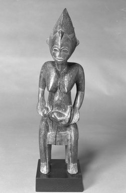 Senufo. <em>Figure of a Mother and Child</em>, 20th century. Wood, pigment, 19 x 5 1/4 x 4 1/2 in. (48.2 x 13.4 x 11.4 cm). Brooklyn Museum, The Adolph and Esther D. Gottlieb Collection, 1989.51.16. Creative Commons-BY (Photo: Brooklyn Museum, 1989.51.16_bw.jpg)