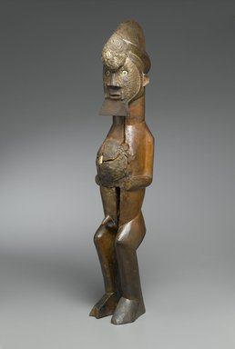 Master of Mayama. <em>Figure of Standing Male (Nkisi)</em>, late 19th century. Wood, shell, mud, metal, resin, organic materials, imported buttons, 25 1/2 x 4 1/4 x 4 3/4 in. (64.8 x 10.8 x 12.1 cm). Brooklyn Museum, The Adolph and Esther D. Gottlieb Collection, 1989.51.19. Creative Commons-BY (Photo: Brooklyn Museum, 1989.51.19_PS2.jpg)