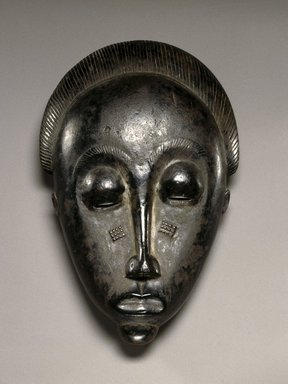 Baule. <em>Mblo Portrait Mask</em>, late 19th or early 20th century. Wood, oils, pigment, 10 1/2 x 5 3/8 x 3 in.(26.7 x 13.7 x 7.6 cm). Brooklyn Museum, The Adolph and Esther D. Gottlieb Collection, 1989.51.25. Creative Commons-BY (Photo: Brooklyn Museum, 1989.51.25_SL1.jpg)