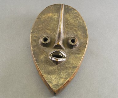 Dan. <em>Mask</em>, 20th century. Wood, metal, 7 7/8 x 4 7/8 x 1 3/4 in. (20 x 12.4 x 4.4 cm). Brooklyn Museum, The Adolph and Esther D. Gottlieb Collection, 1989.51.26. Creative Commons-BY (Photo: Brooklyn Museum, 1989.51.26_front_PS5.jpg)