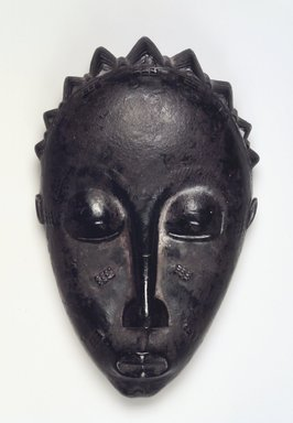 Baule. <em>Mblo Portrait Mask</em>, late 19th or early 20th century. Wood, oils, pigment, ferrous nails, 8 3/4 x 5 1/4 x 2 1/2 in. (22.2 x 13.3 x 6.4 cm). Brooklyn Museum, The Adolph and Esther D. Gottlieb Collection, 1989.51.27. Creative Commons-BY (Photo: Brooklyn Museum, 1989.51.27.jpg)