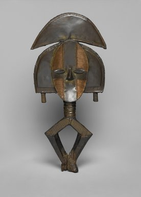 Kota. <em>Reliquary Guardian Figure (Mbulu Ngulu)</em>, late 19th century. Wood, copper, brass, 20 1/4 x 8 3/4 x 2 1/4in. (51.4 x 22.2 x 5.7cm). Brooklyn Museum, The Adolph and Esther D. Gottlieb Collection, 1989.51.2. Creative Commons-BY (Photo: Brooklyn Museum, 1989.51.2_PS2.jpg)