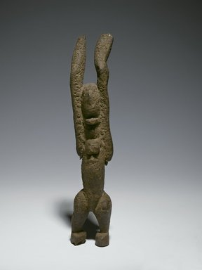 Dogon. <em>Nommo Figure with Raised Arms</em>, 11th-15th century (possibly). Wood, organic sacrificial materials, 10 1/2 x 2 7/8 x 1 3/4 in. (26.7 x 7.3 x 4.4 cm). Brooklyn Museum, The Adolph and Esther D. Gottlieb Collection, 1989.51.39. Creative Commons-BY (Photo: Brooklyn Museum, 1989.51.39_PS6.jpg)