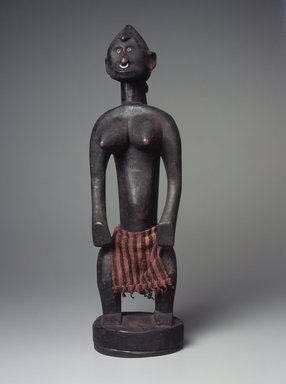 Bamana. <em>Figure of a Standing Female (Nyeleni)</em>, 20th century. Wood, metal, cloth, 16 3/4 x 5 1/4 x 5 1/2 in. (42.5 x 13.3 14 cm). Brooklyn Museum, The Adolph and Esther D. Gottlieb Collection, 1989.51.4. Creative Commons-BY (Photo: Brooklyn Museum, 1989.51.4.jpg)