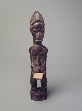 Baule. <em>Male Figure (Blolo Bian)</em>, late 19th or early 20th century. Wood, cloth, 11 3/8 x 2 1/2 x 2 3/8 in.  (28.9 x 6.4 x 6.0 cm). Brooklyn Museum, The Adolph and Esther D. Gottlieb Collection, 1989.51.43. Creative Commons-BY (Photo: Brooklyn Museum, 1989.51.43.jpg)