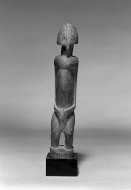 Dogon. <em>Standing Figure with Helmet-Shaped Head</em>, late 19th or early 20th century. Wood, 11 3/4 x 2 1/8 x 2 3/8 in. (29.8 x 5.4 x 6 cm). Brooklyn Museum, The Adolph and Esther D. Gottlieb Collection, 1989.51.48. Creative Commons-BY (Photo: Brooklyn Museum, 1989.51.48_bw.jpg)