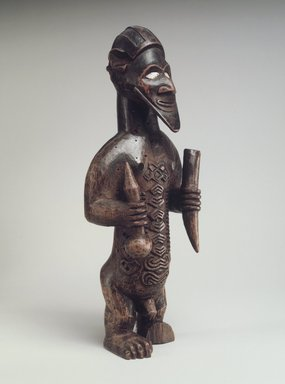 Beembe. <em>Male Figure (Bimbi)</em>, 19th century. Wood, shell, 5 3/4 x 2 1/8 x 1 1/2in. (14.6 x 5.4 x 3.8cm). Brooklyn Museum, The Adolph and Esther D. Gottlieb Collection, 1989.51.56. Creative Commons-BY (Photo: Brooklyn Museum, 1989.51.56.jpg)