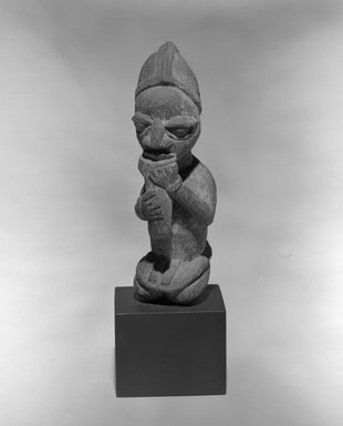 Yorùbá. <em>Kneeling Figure Blowing Whistle</em>, late 19th or early 20th century. Wood, pigment, sacrificial patina, 8 1/16 x 2 1/2 x 2 1/2 in. Brooklyn Museum, The Adolph and Esther D. Gottlieb Collection, 1989.51.59. Creative Commons-BY (Photo: Brooklyn Museum, 1989.51.59_bw.jpg)