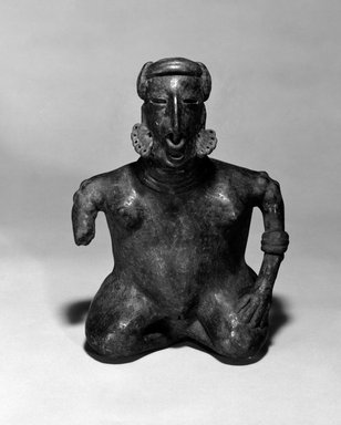 Protoclassic. <em>Seated Female</em>. Clay, pigment, 11 x 7 3/4 x 4 1/4 in. (27.9 x 19.7 x 10.8 cm). Brooklyn Museum, The Adolph and Esther D. Gottlieb Collection, 1989.51.64. Creative Commons-BY (Photo: Brooklyn Museum, 1989.51.64_bw.jpg)