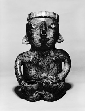 Nayarit. <em>Seated Male Figure</em>, 300 B.C.E.-200 C.E. Ceramic, slip, 14 × 8 1/8 × 7 7/8 in., 9.5 lb. (35.6 × 20.6 × 20 cm, 4.31kg). Brooklyn Museum, The Adolph and Esther D. Gottlieb Collection, 1989.51.66. Creative Commons-BY (Photo: Brooklyn Museum, 1989.51.66_bw.jpg)