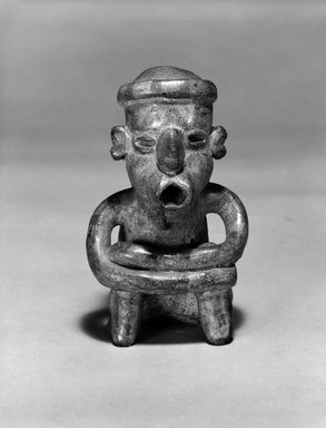 Nayarit. <em>Seated Figurine</em>, 100-300. Ceramic, slip, 5 1/2 × 3 3/8 × 3 3/8 in. (14 × 8.6 × 8.6 cm). Brooklyn Museum, The Adolph and Esther D. Gottlieb Collection, 1989.51.67. Creative Commons-BY (Photo: Brooklyn Museum, 1989.51.67_bw.jpg)