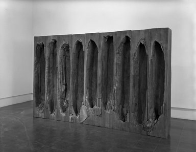 Ursula von Rydingsvard (American, born Germany, 1942). <em>Umarles (You Went and Died)</em>, 1987-1988. Cedar, stain, 78 x 126 x 13 1/2 in. (198.1 x 320 x 34.3 cm). Brooklyn Museum, Gift of the Contemporary Art Council, 1989.5a-n. © artist or artist's estate (Photo: Brooklyn Museum, 1989.5a-n_bw.jpg)