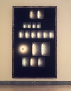 Jon Kessler (American, born 1957). <em>Peter Kubelka</em>, 1988. Mixed media construction with electrical wiring--wood, metal, woolen fabric, fluorescent tubes, incadescent lightbulb, 102 x 61 x 7 1/2 in.  (259.1 x 154.9 x 19.1 cm). Brooklyn Museum, A. Augustus Healy Fund and John W. James Fund, 1989.79. © artist or artist's estate (Photo: Brooklyn Museum, 1989.79.jpg)