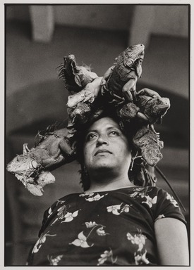 Graciela Iturbide (Mexican, born 1942). <em>Nuestra Señora de las Iguanas (Our Lady of the Iguanas), Juchitán, Oaxaca</em>, 1979. Gelatin silver photograph, image: 8 3/4 x 6 1/8 in. (22.2 x 15.6 cm). Brooklyn Museum, Gift of Marcuse Pfeifer, 1990.119.30. © artist or artist's estate (Photo: , 1990.119.30_PS9.jpg)