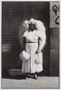 Graciela Iturbide (Mexican, born 1942). <em>Vendedora de Zacate (Sponge Vendor), Oaxaca</em>, 1974. Gelatin silver photograph, image: 12 x 8 in. (30.5 x 20.3 cm). Brooklyn Museum, Gift of Marcuse Pfeifer, 1990.119.39. © artist or artist's estate (Photo: , 1990.119.39_PS9.jpg)