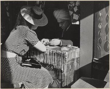 John Albok (American, born Hungary, 1894-1982). <em>Amusement (Tarot Card Reader)</em>, 1938. Gelatin silver photograph, 7 3/4 x 9 1/2 in. (19.7 x 24.1 cm). Brooklyn Museum, Gift of Ilona Albok Vitarius, 1990.122.11. © artist or artist's estate (Photo: Brooklyn Museum, 1990.122.11_PS9.jpg)