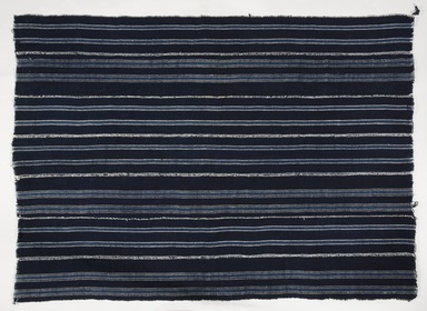 Yorùbá. <em>Woman's wrapper (aṣọ-òkè)</em>, 20th century. Cotton, rayon, indigo, 56 1/2 × 40 1/2 × 1/8 in. (143.5 × 102.9 × 0.3 cm). Brooklyn Museum, Purchased with funds given by Frieda and Milton F. Rosenthal, 1990.132.1. Creative Commons-BY (Photo: , 1990.132.1_PS11.jpg)