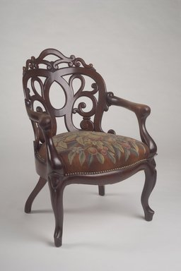 Attributed to John Henry Belter (American, born Germany, 1804-1863). <em>Armchair</em>, ca. 1860. Wood, upholstery, 34 3/8 x 24 1/4 x 25 3/4 in. Brooklyn Museum, Bequest of DeLancey Thorn Grant in memory of her mother, Louise Floyd-Jones Thorn, 1990.145.4. Creative Commons-BY (Photo: Brooklyn Museum, 1990.145.4.jpg)