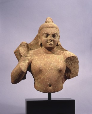 <em>Buddha Torso</em>, 2nd century C.E. Mottled red sandstone, 12 1/2 x 10 3/4 x 4 5/8 in. Brooklyn Museum, Gift of Michael de Havenon, 1990.184. Creative Commons-BY (Photo: Brooklyn Museum, 1990.184_SL1.jpg)