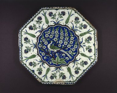 <em>Octagonal Tile Depicting Peacock in Prunus Tree</em>, 16th century. Ceramic; fritware, painted in black, cobalt blue, green, and manganese purple under a transparent glaze, 15 1/2 x 1 1/8 in. (39.4 x 2.9 cm). Brooklyn Museum, Gift of Jack A. Josephson, 1990.21. Creative Commons-BY (Photo: Brooklyn Museum, 1990.21_SL1.jpg)