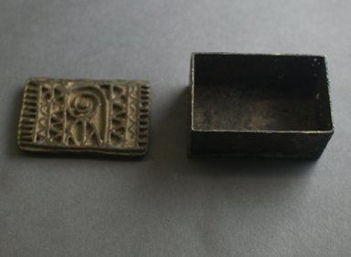 Asante. <em>Rectangular Gold Weight Box</em>, 19th century. Copper alloy, 1 15/16 x 1 5/8 x 3 5/8 in. (5 x 4.2 x 9.2 cm). Brooklyn Museum, Gift of Shirley B. Williams, 1990.221.10a-b. Creative Commons-BY (Photo: Brooklyn Museum, 1990.221.10a-b_front_PS5.jpg)